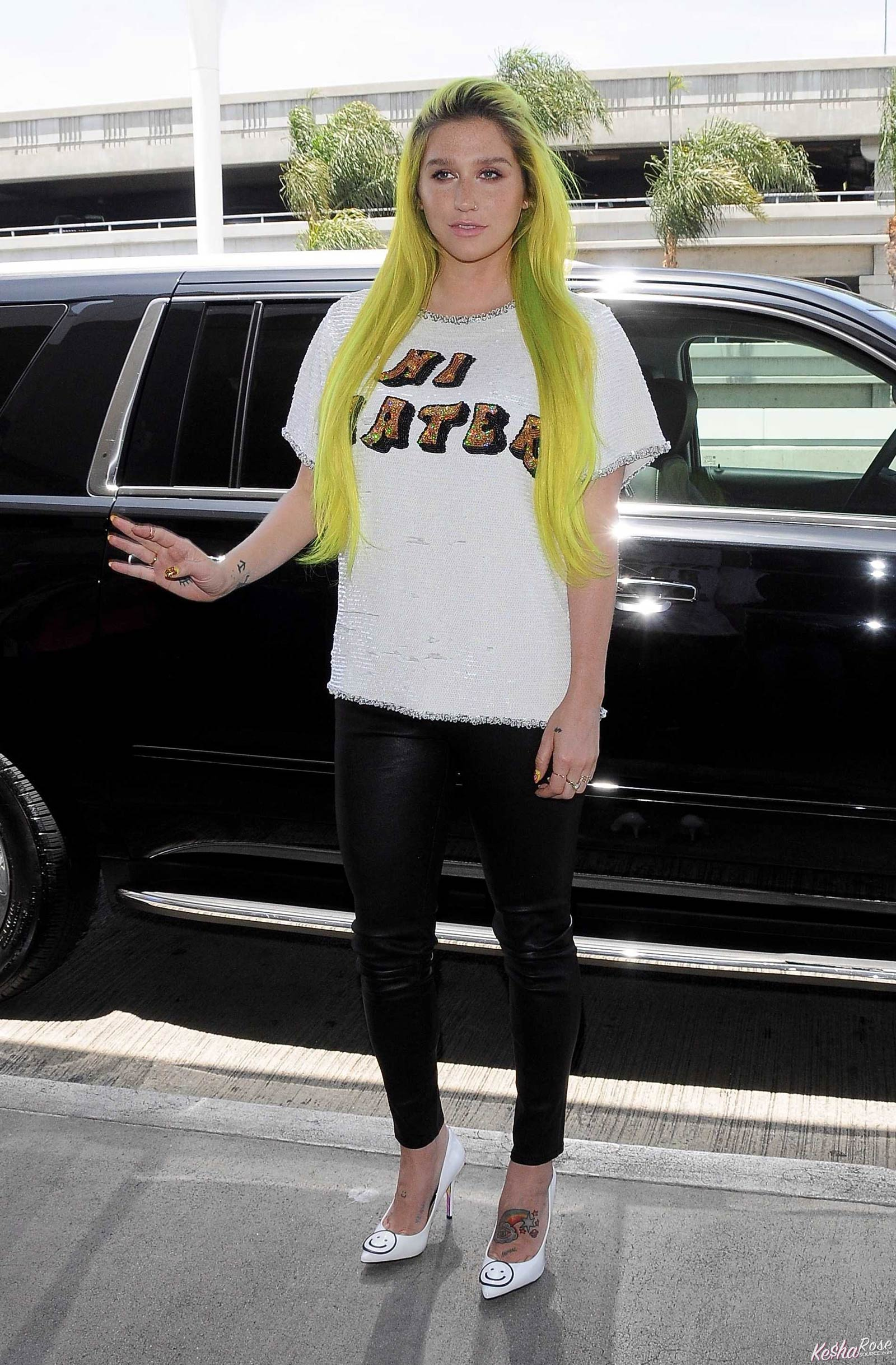 Kesha departing on a flight at LAX airport