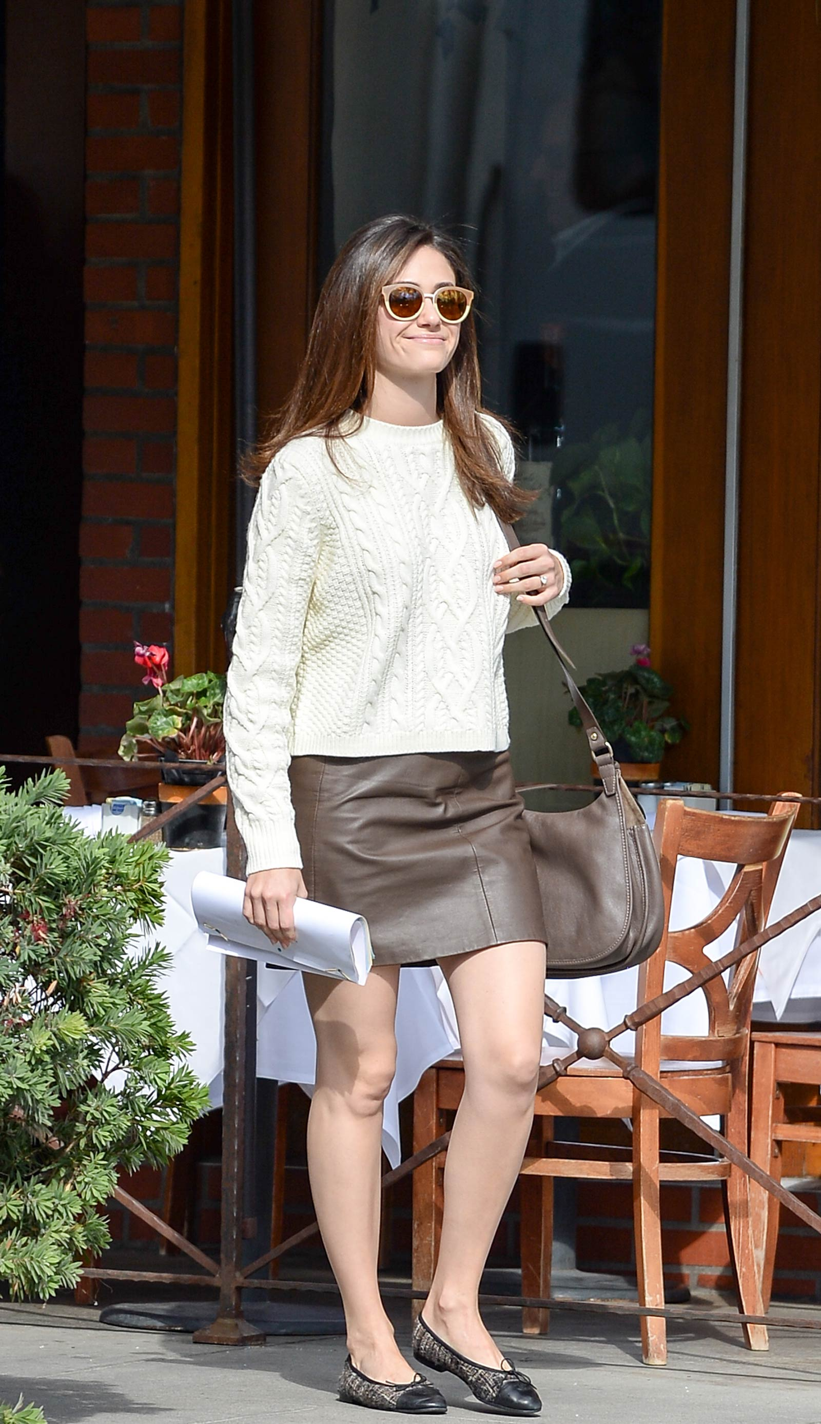 Emmy Rossum heads back to her car