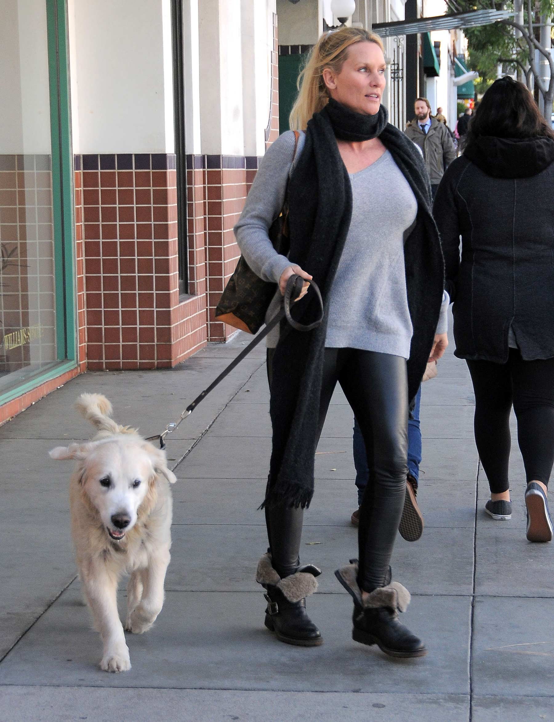 Nicollette Sheridan out with her dog in Beverly Hills
