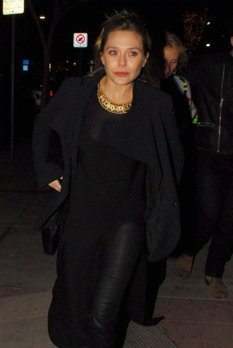 Elizabeth Olsen attends the premiere of Hail, Caesar!