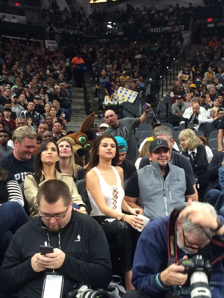 Selena Gomez attends the San Antonio Spurs vs LA Lakers basketball game