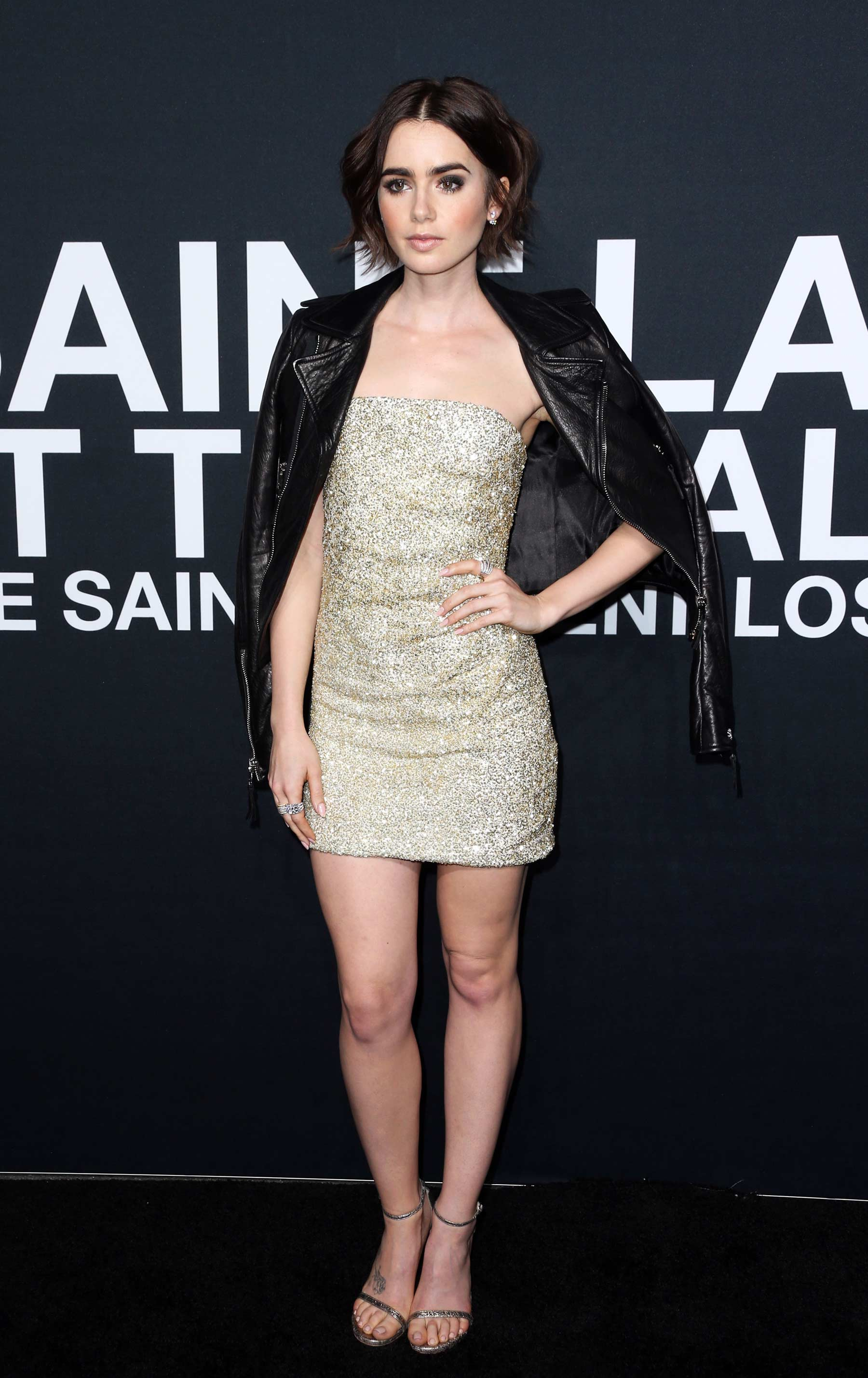 Lily Collins attends Saint Laurent Fashion Show