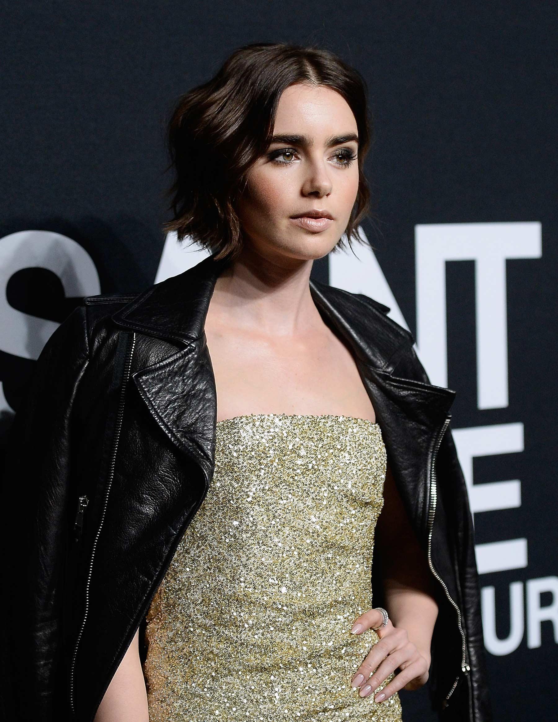 Lily Collins attends Saint Laurent Fashion Show