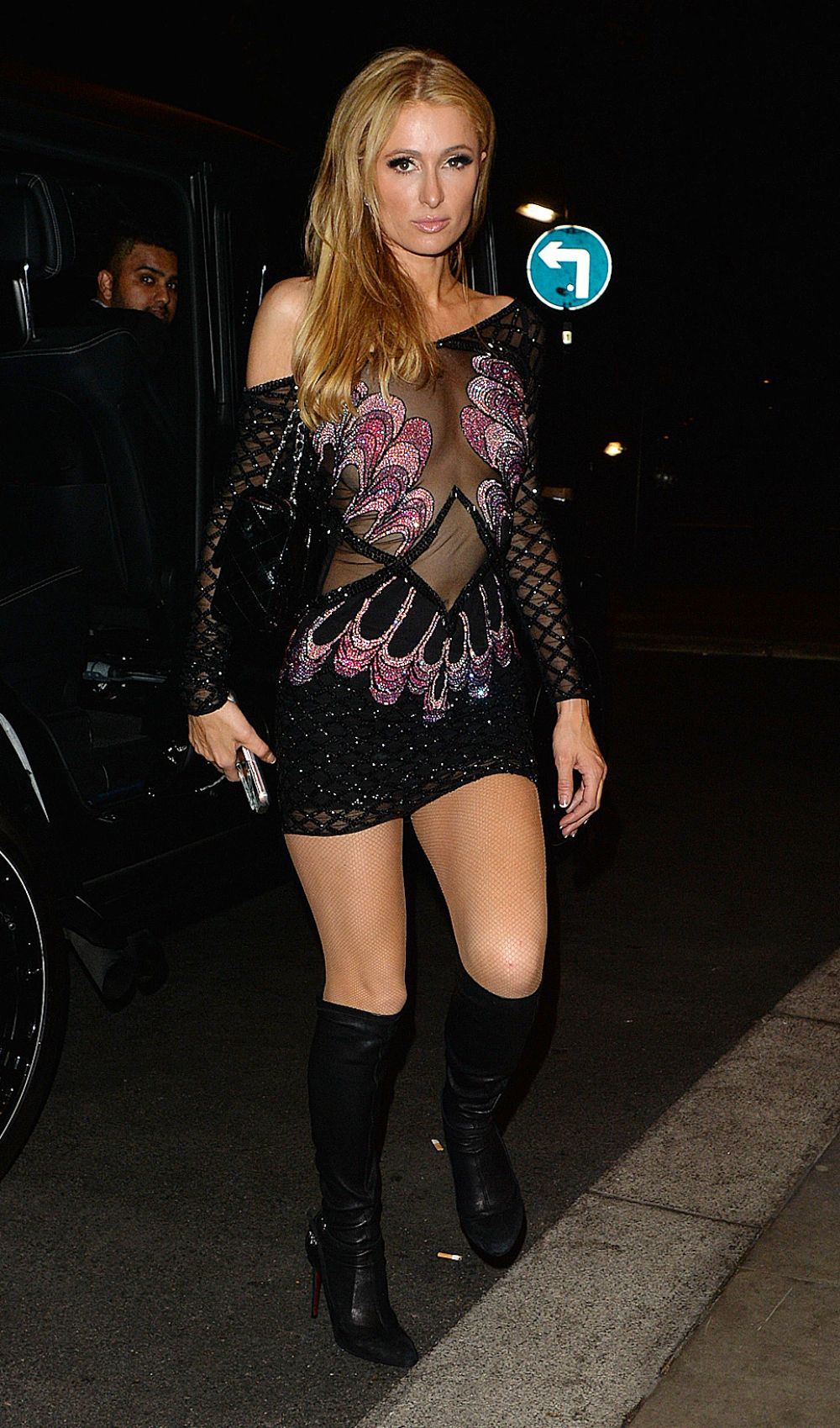 Paris Hilton returns to her hotel after a party