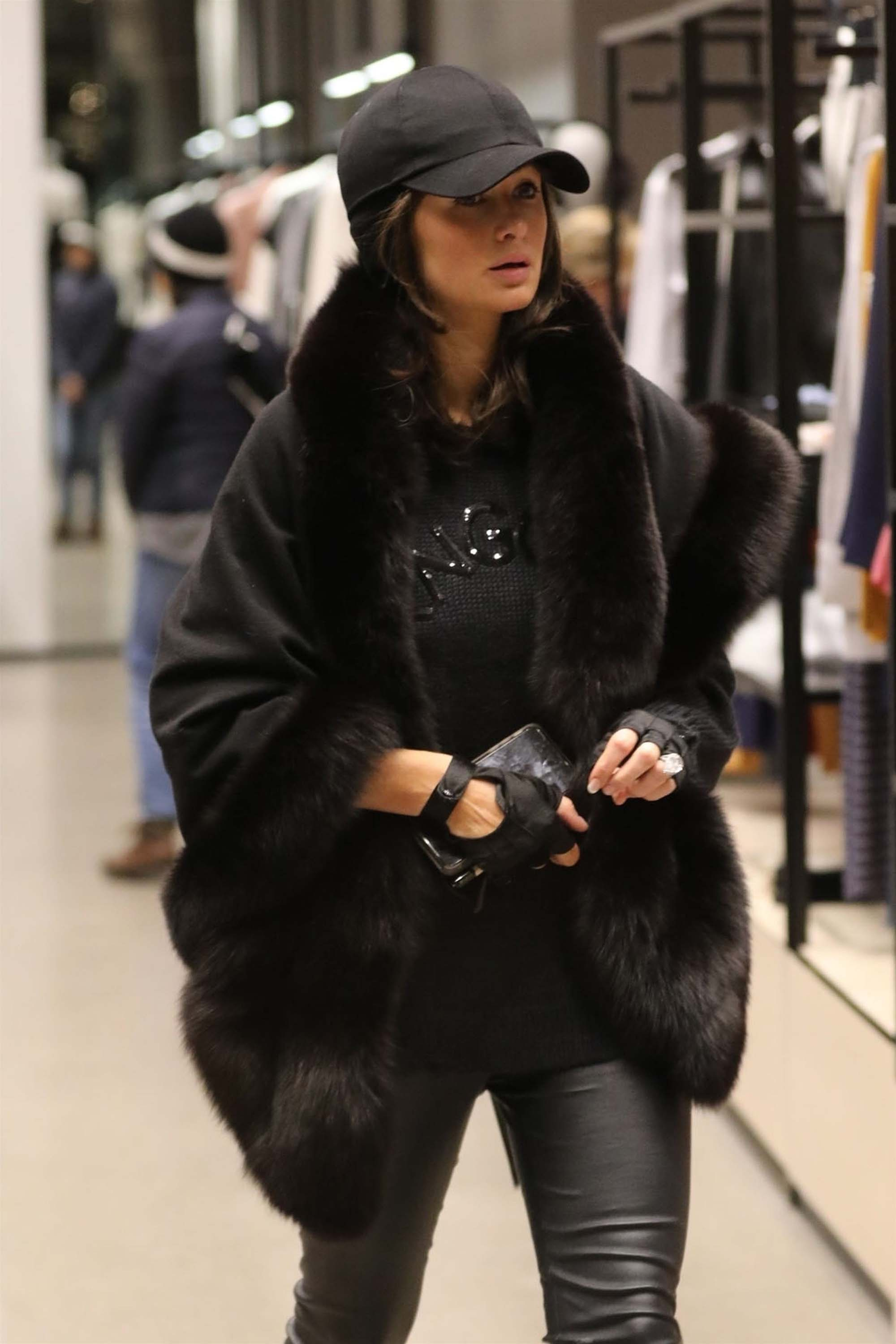Paris Hilton spotted out doing some night time shopping