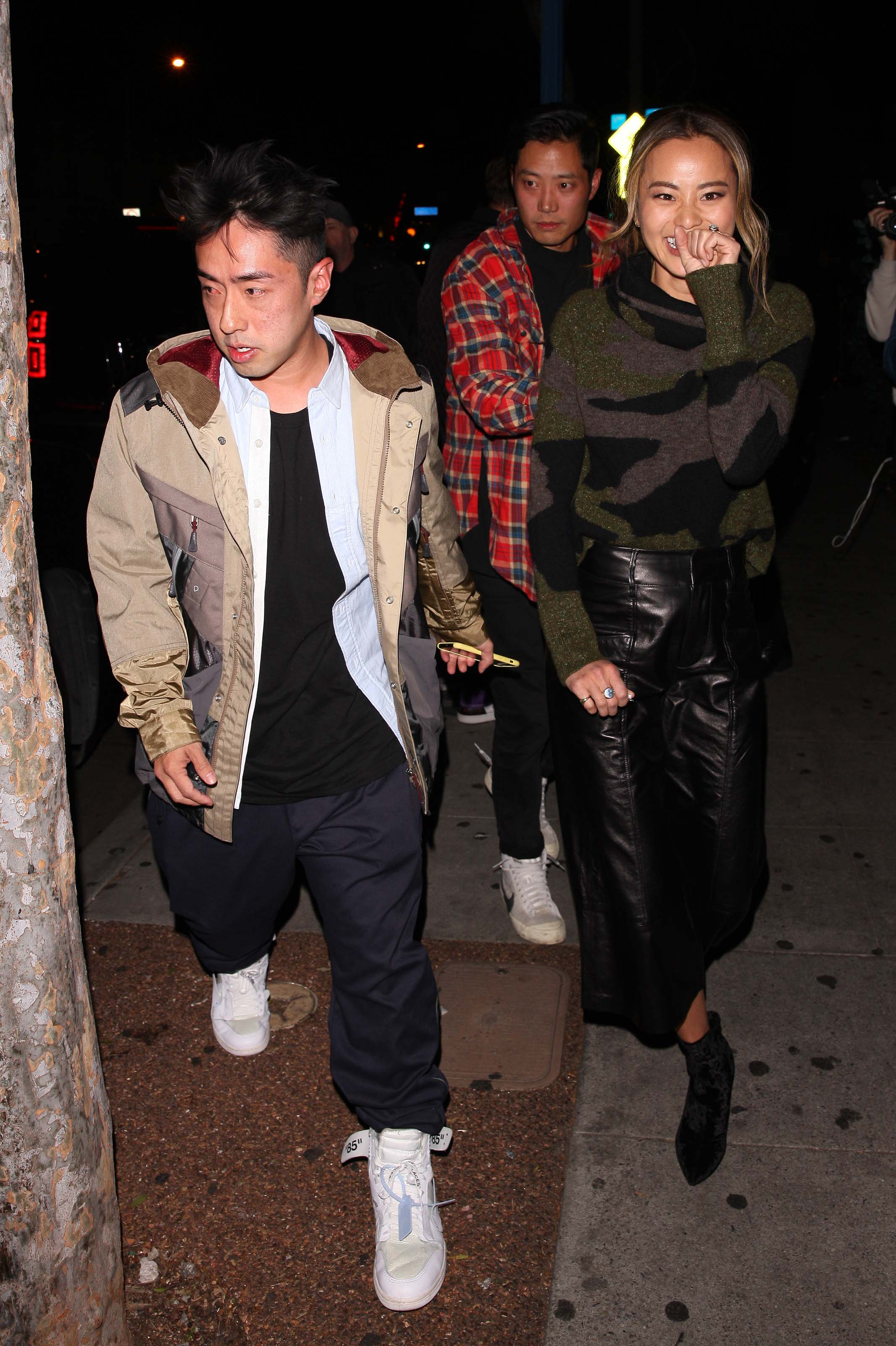 Jamie Chung leaves the Delilah club with a male friend