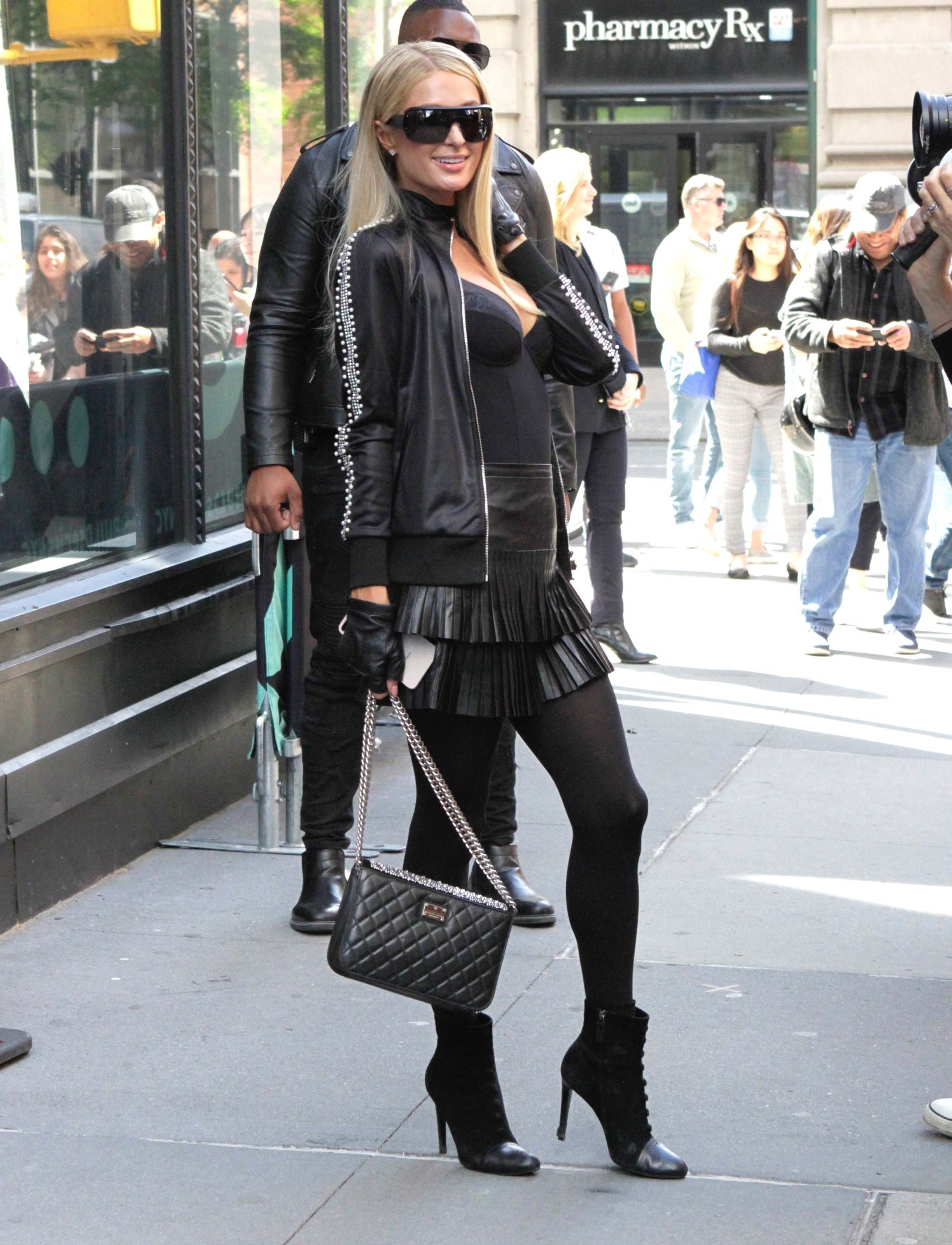 Paris Hilton arrives at the build series