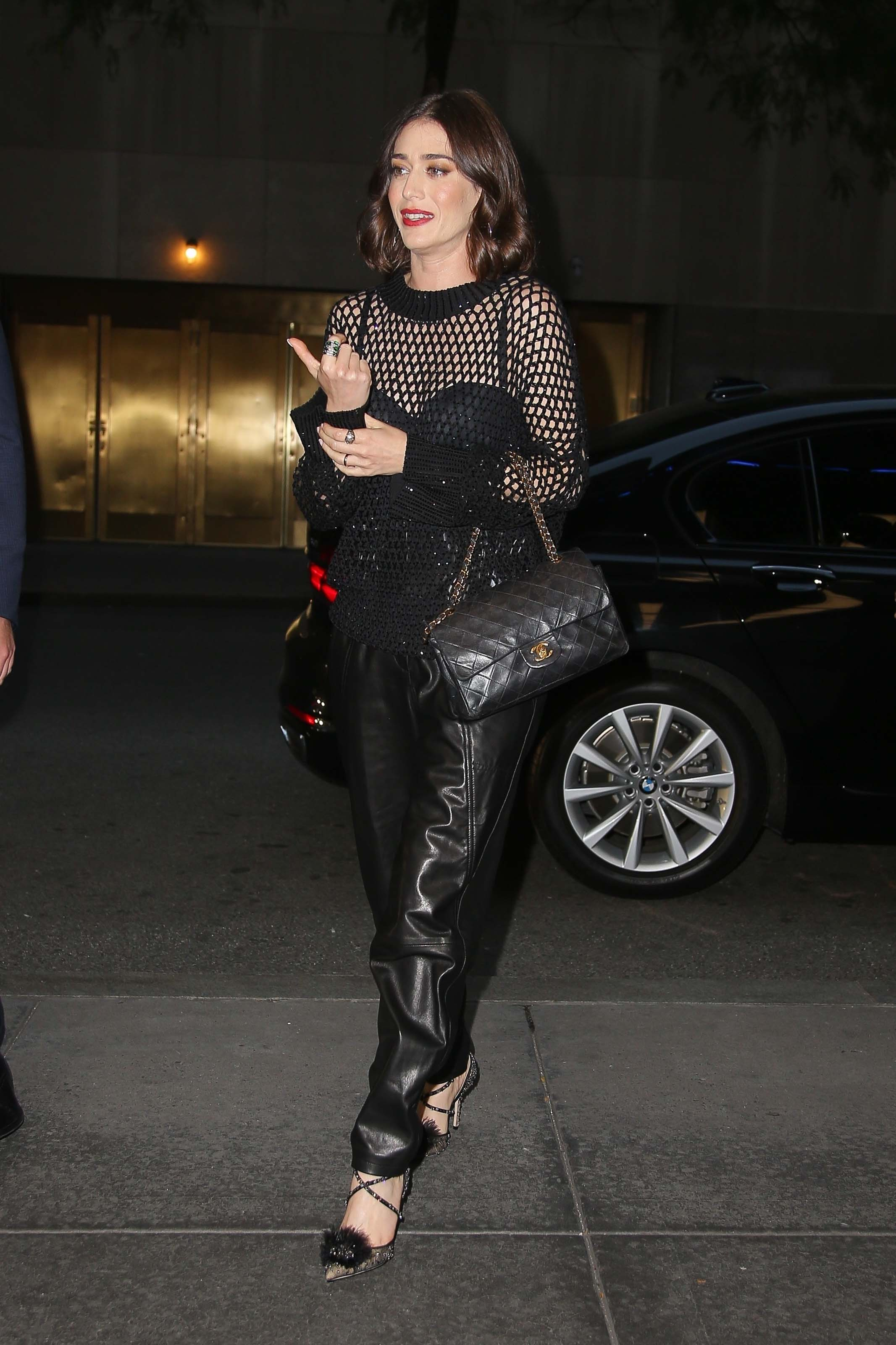 Lizzy Caplan looks stylish in a leather pants