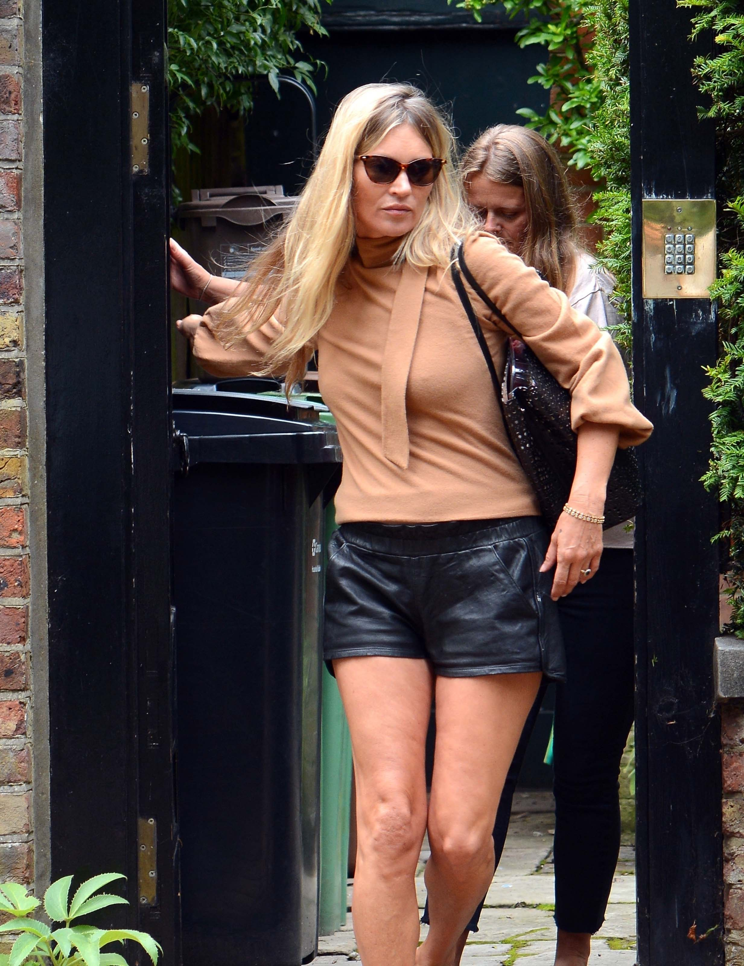 Kate Moss looks stunning in mini leather shorts