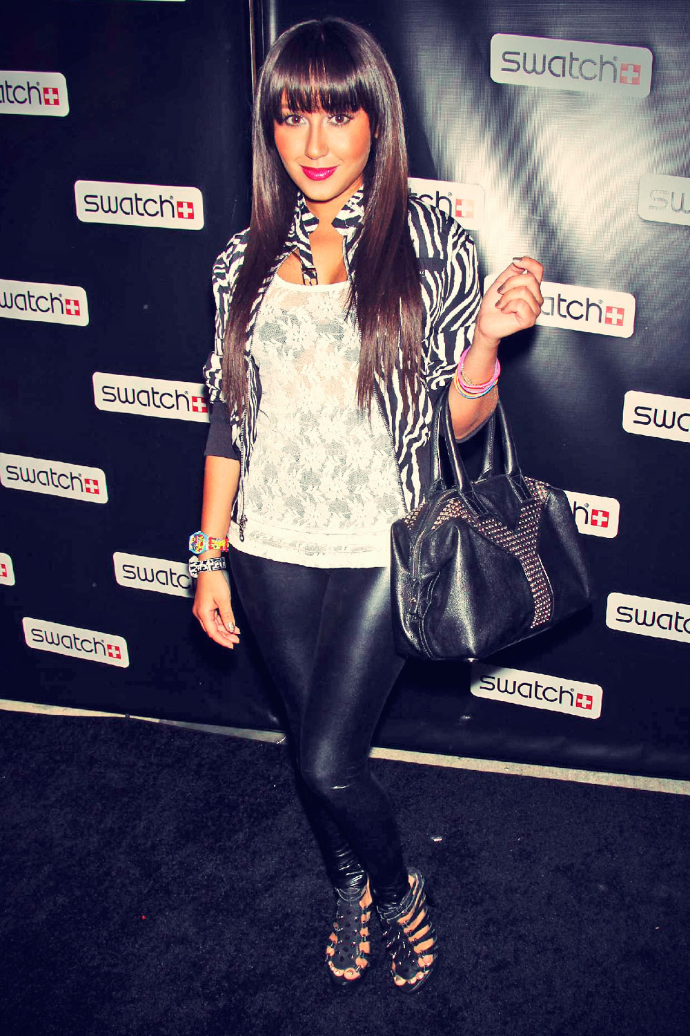 Adrienne Bailon attends the CreArt By Swatch Launch Party