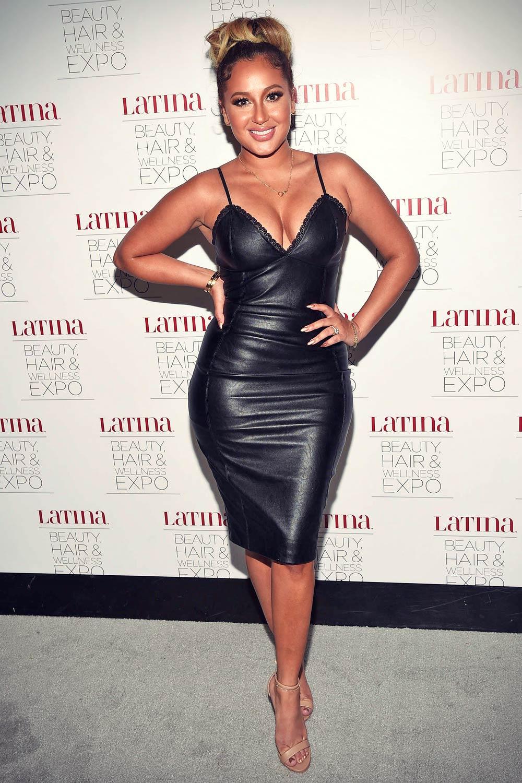 Adrienne Bailon attends the Latina Beauty, Hair & Wellness Expo