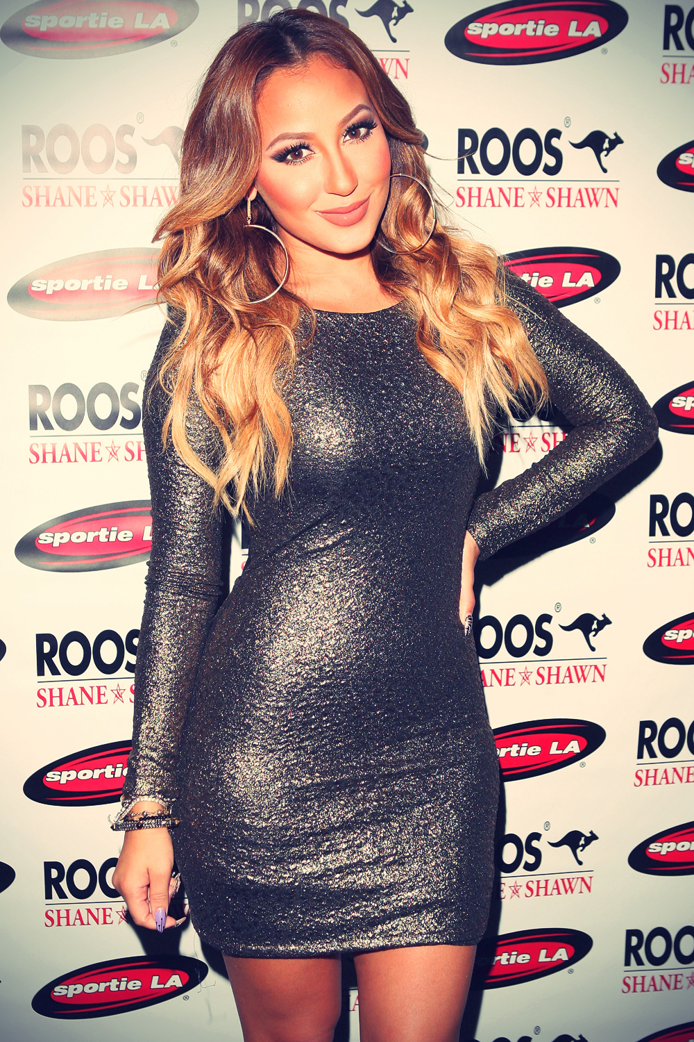 Adrienne Bailon attends the ROOS Shane & Shawn Fashion's Night Out
