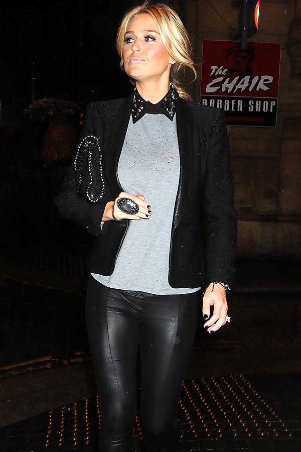 Alex Curran in leather pants and dress