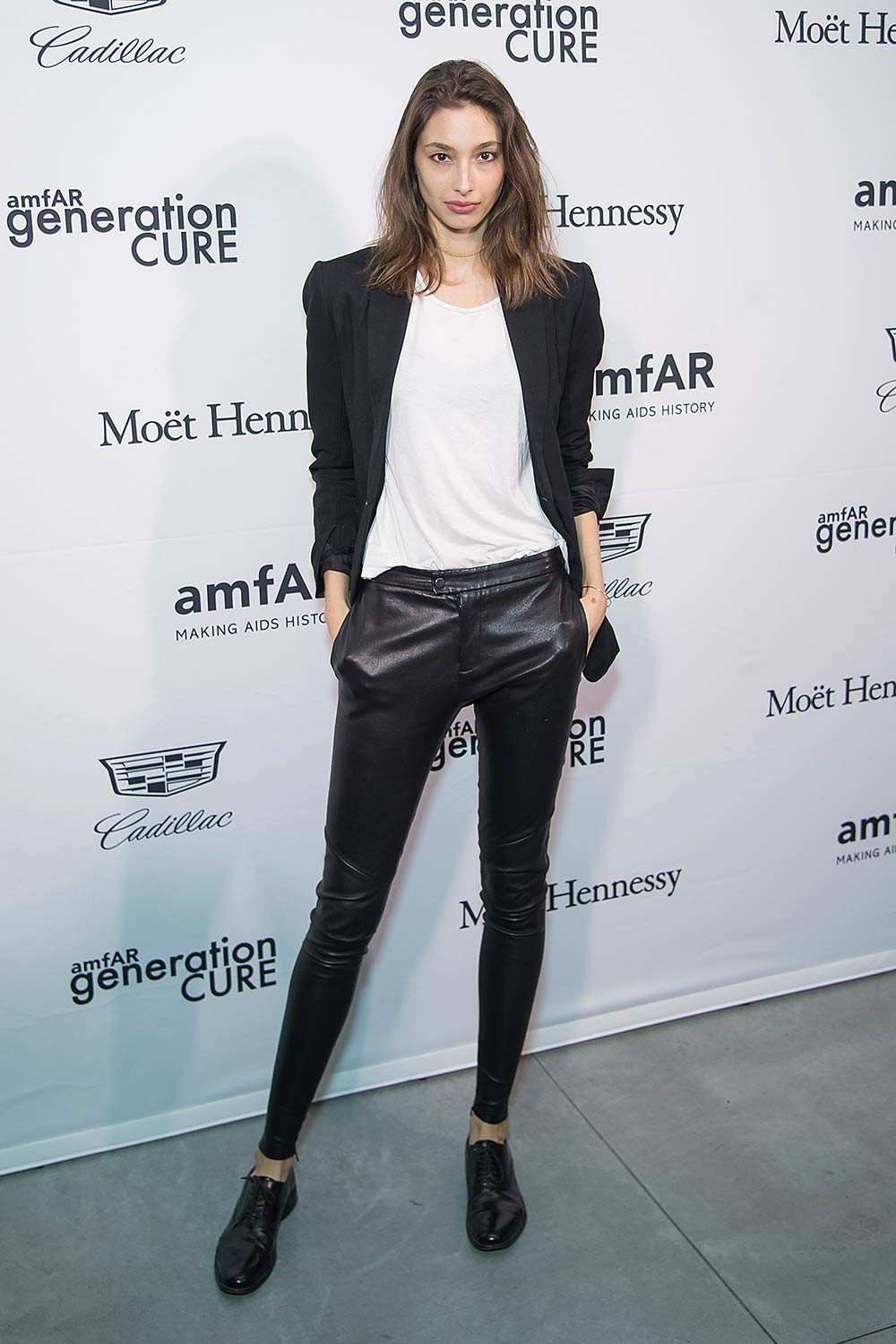 Alexandra Agoston attends the 2016 amfAR GenerationCure Holiday Party