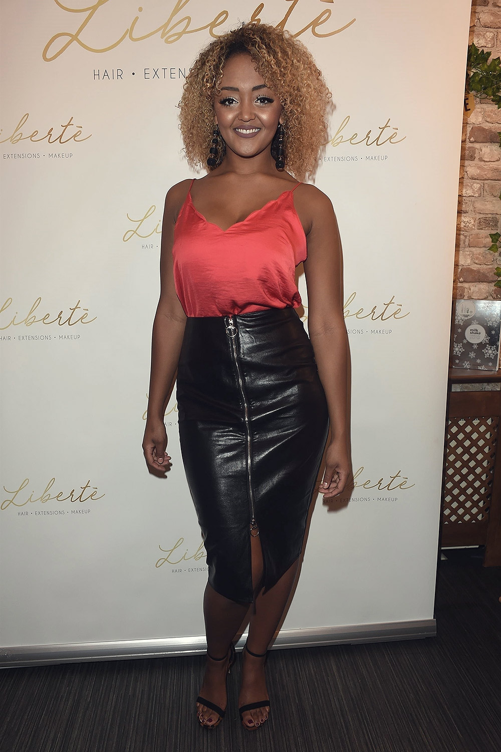 Alexandra Mardell attends the opening of a Hair and Beauty Salon