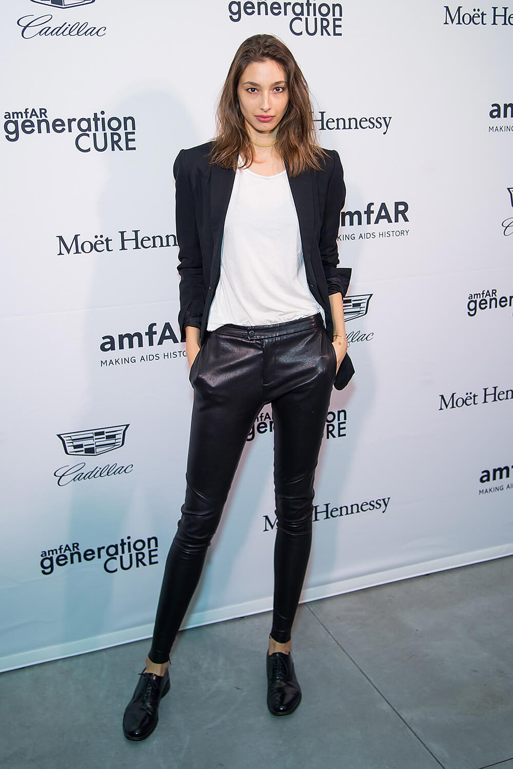 Alexandra Agoston attends amfAR GenerationCure holiday party
