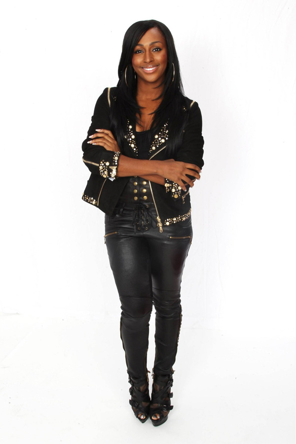 Alexandra Burke poses backstage at the Michael Forever concert at The Millenium Stadium