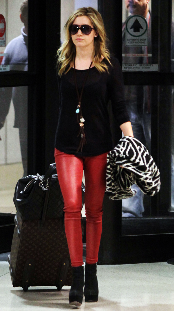 Ashley Tisdale arriving at LAX airport with Martin Johnson