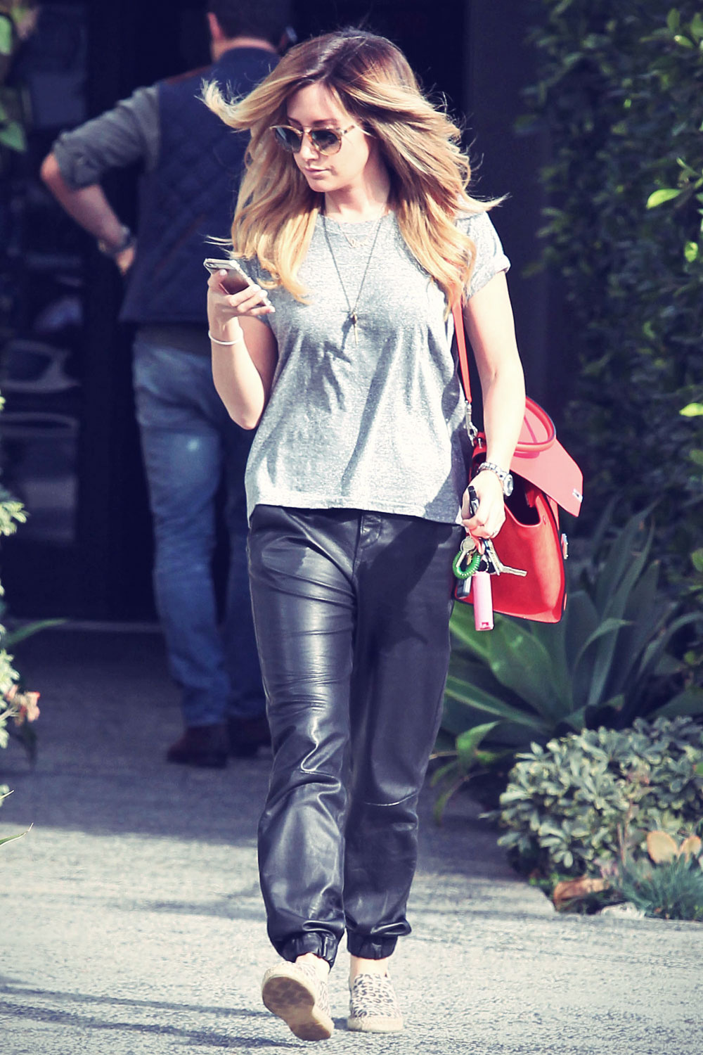 Ashley Tisdale checks out her iPhone as she runs errands around