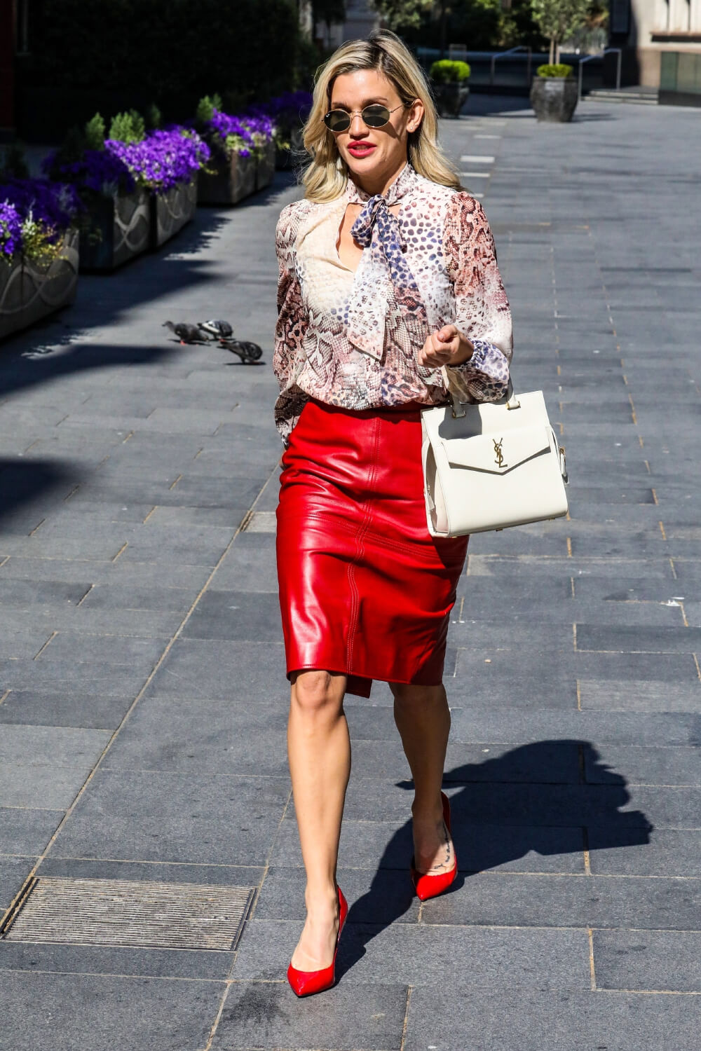 Ashley Roberts looks chic in pencil skirt and print top while leaving the Global studios