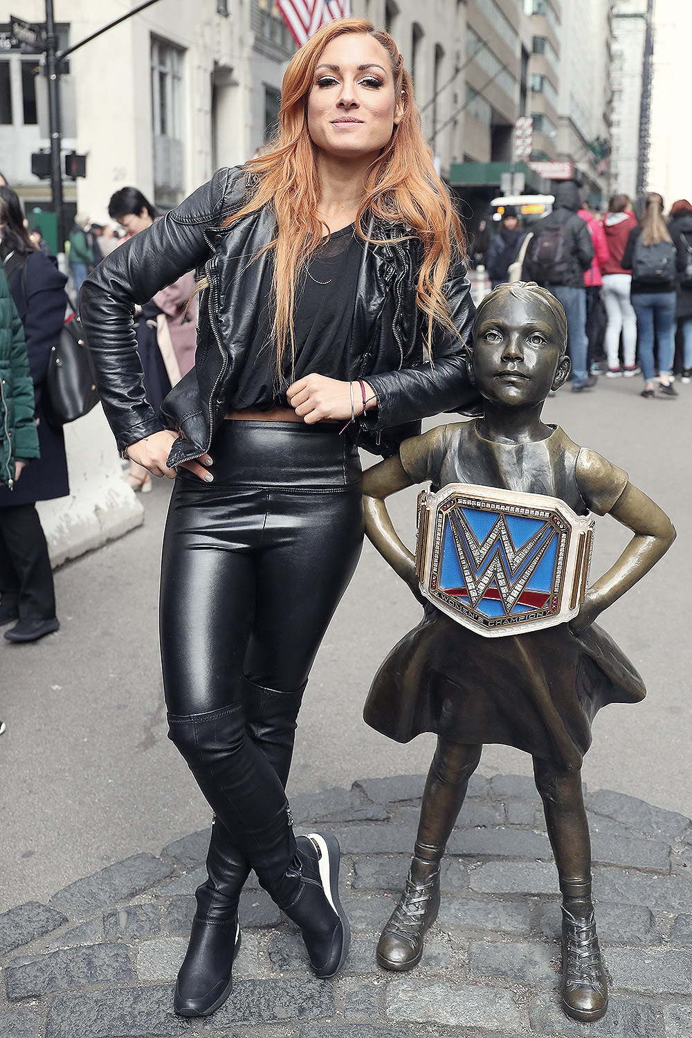 Becky Lynch at Fearless Girl statue in the Wall Street