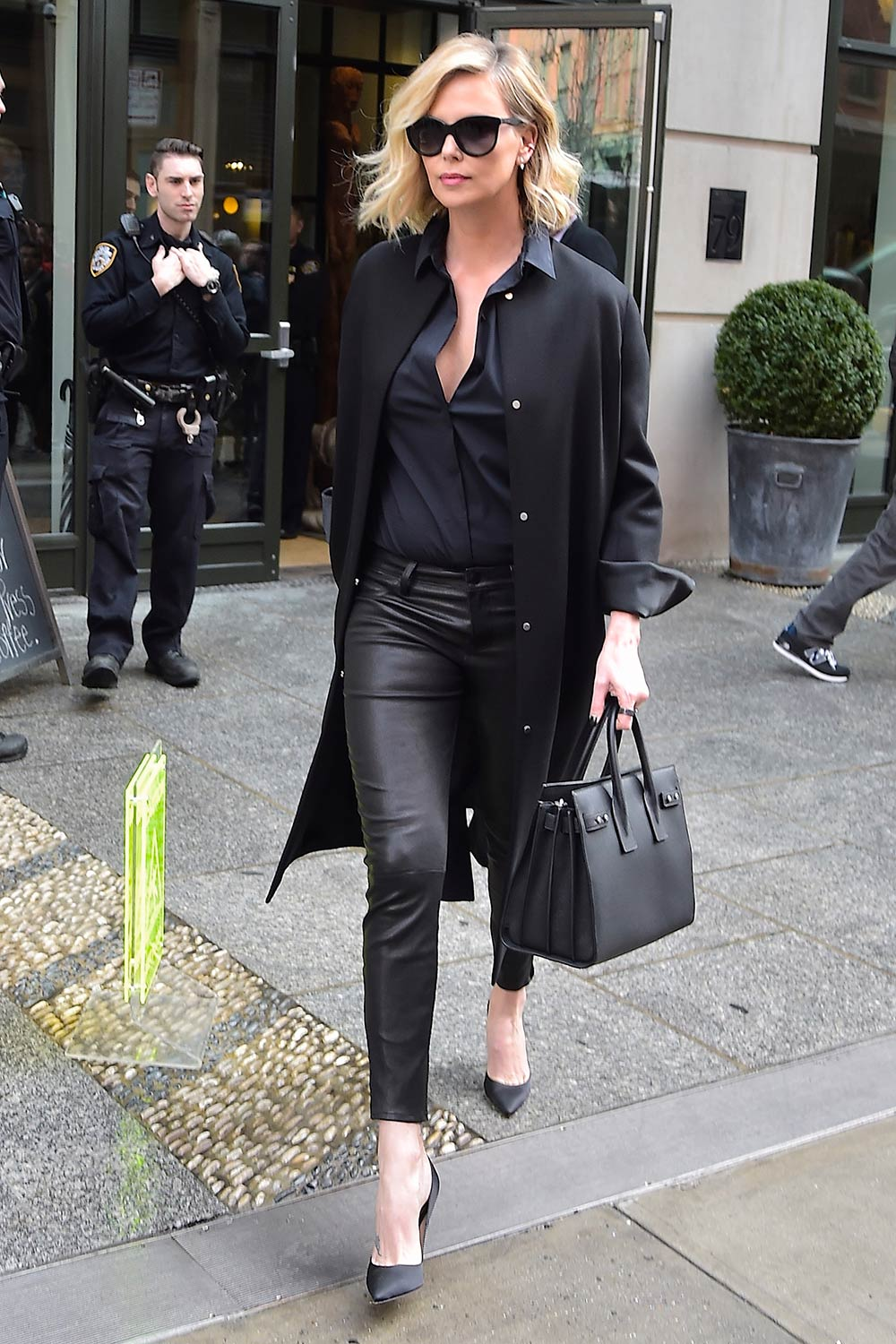 Charlize Theron black leather pants
