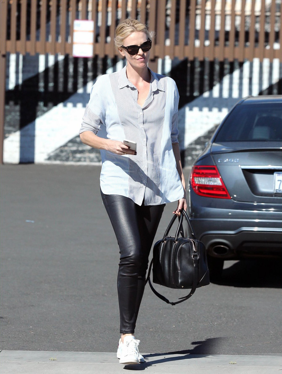 Charlize Theron exits a local restaurant