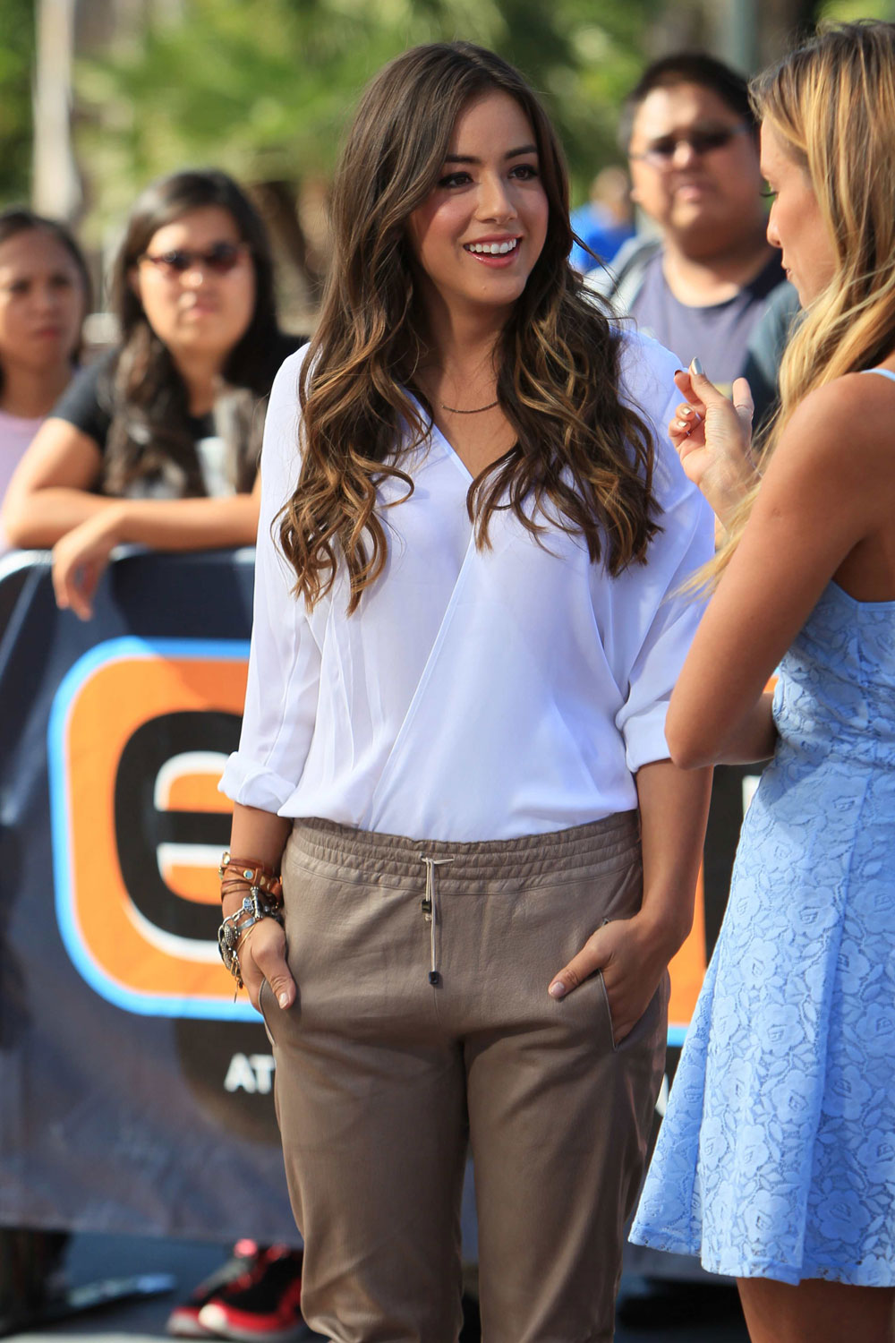 Chloe Bennet on the set of EXTRA with Renee Bargh