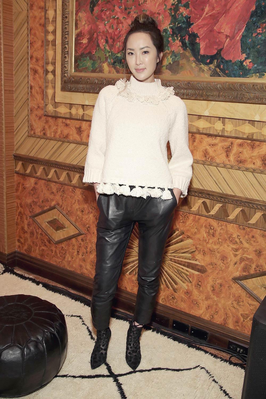 Chriselle Lim poses at kate spade new york Spring 2017 Fashion Presentation