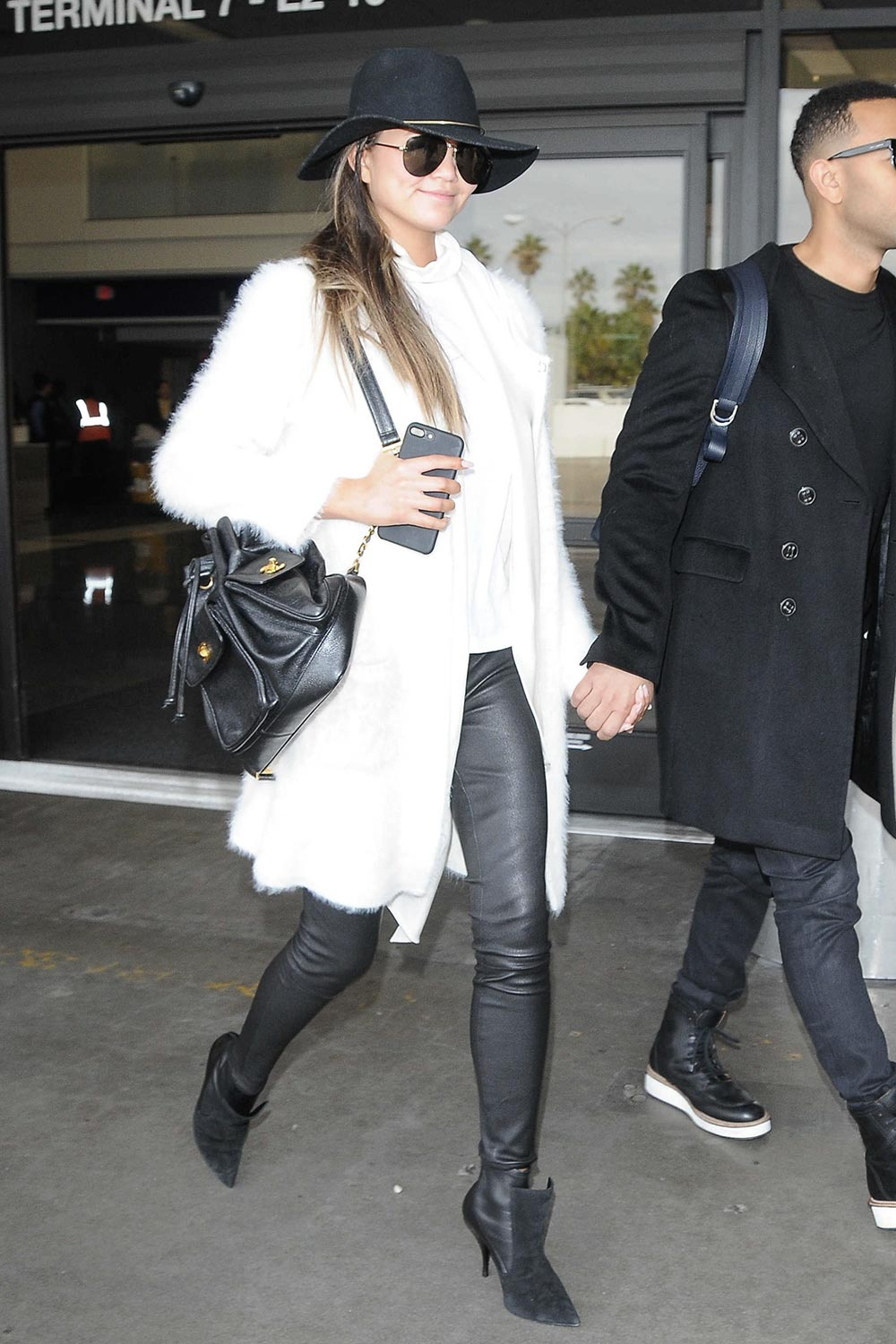 Chrissy Teigen arriving at LAX