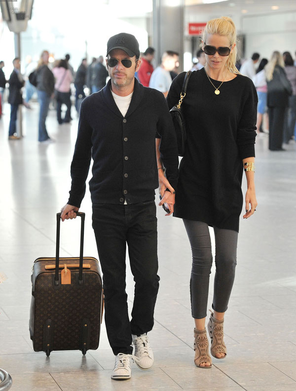 Claudia Schiffer and Matthew Vaughn at Heathrow Airport