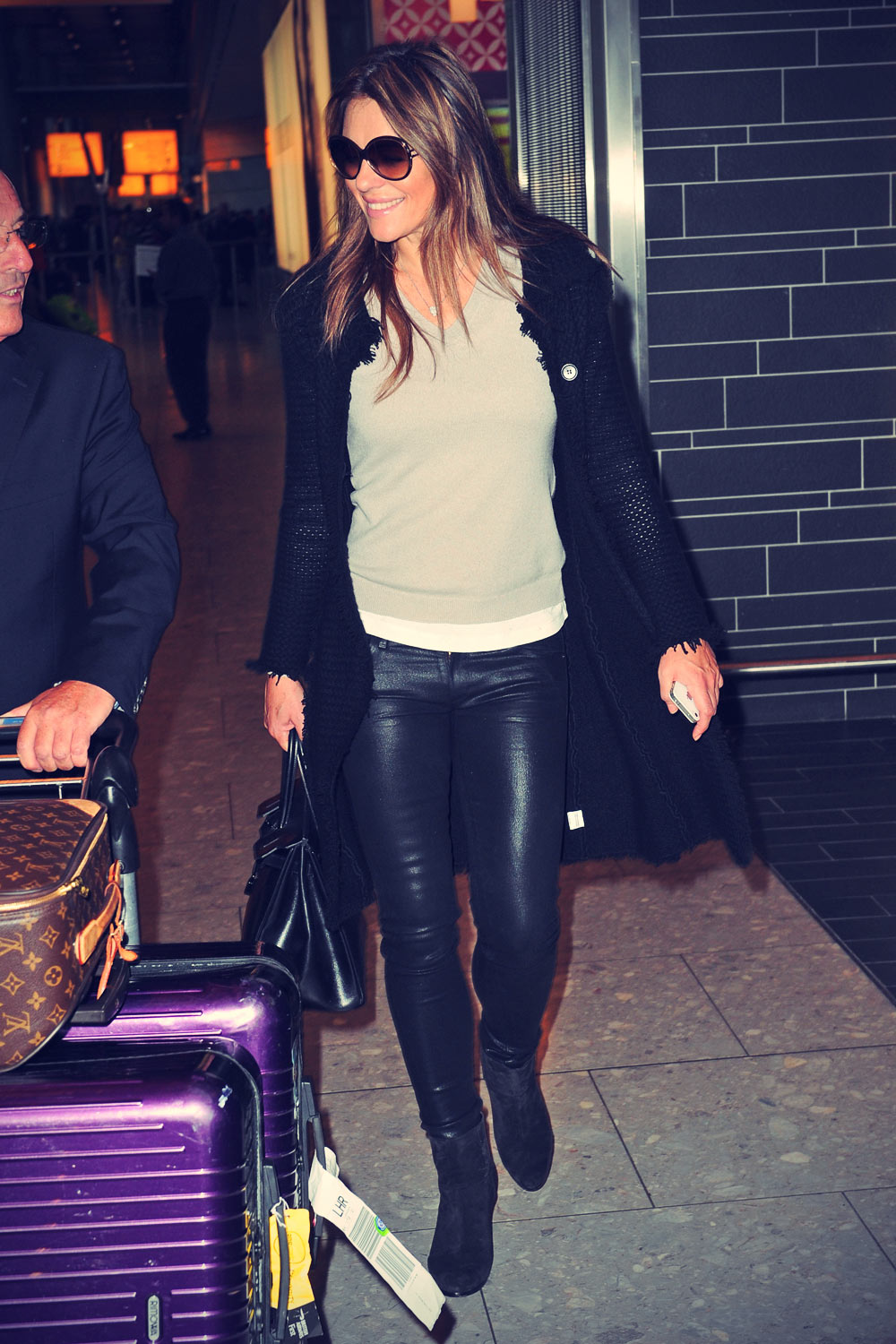 Elizabeth Hurley arrives back in London from NYC