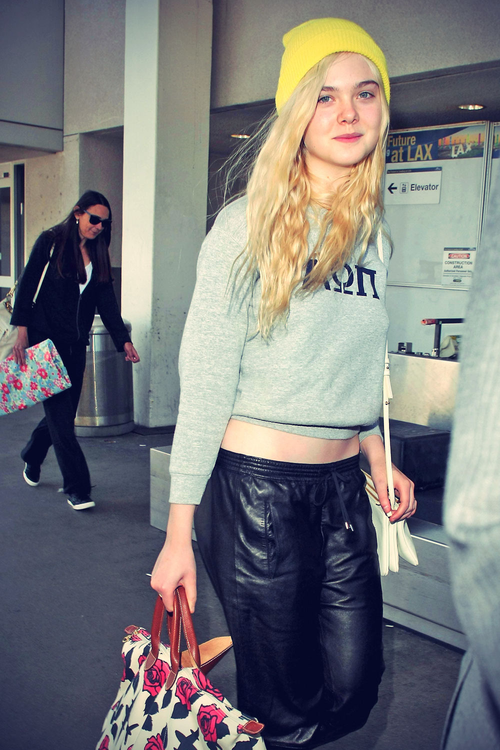 Elle Fanning LAX airport arrival candids in LA