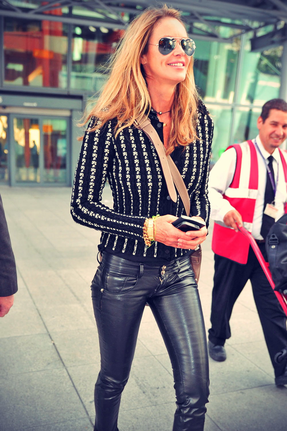 Elle Macpherson arrives at Heathrow Airport