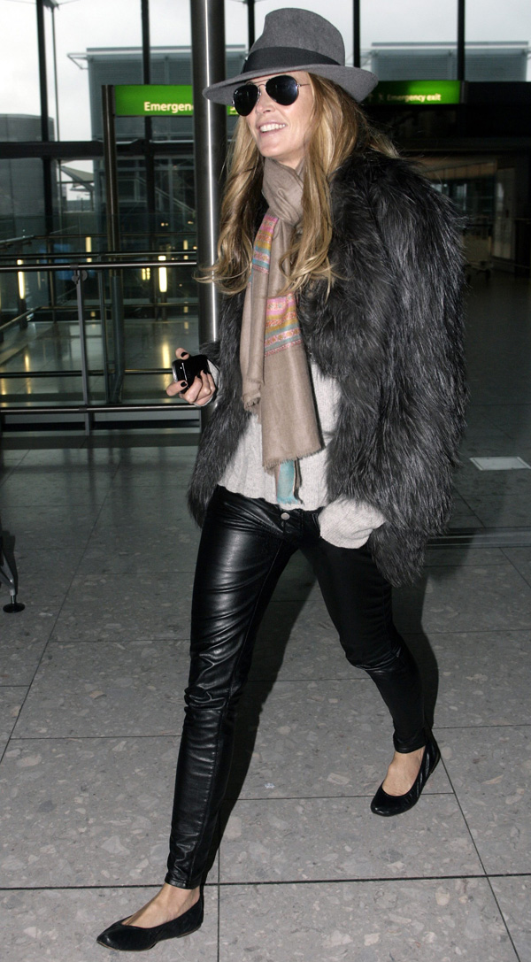 Elle Macpherson at Heathrow Airport in London
