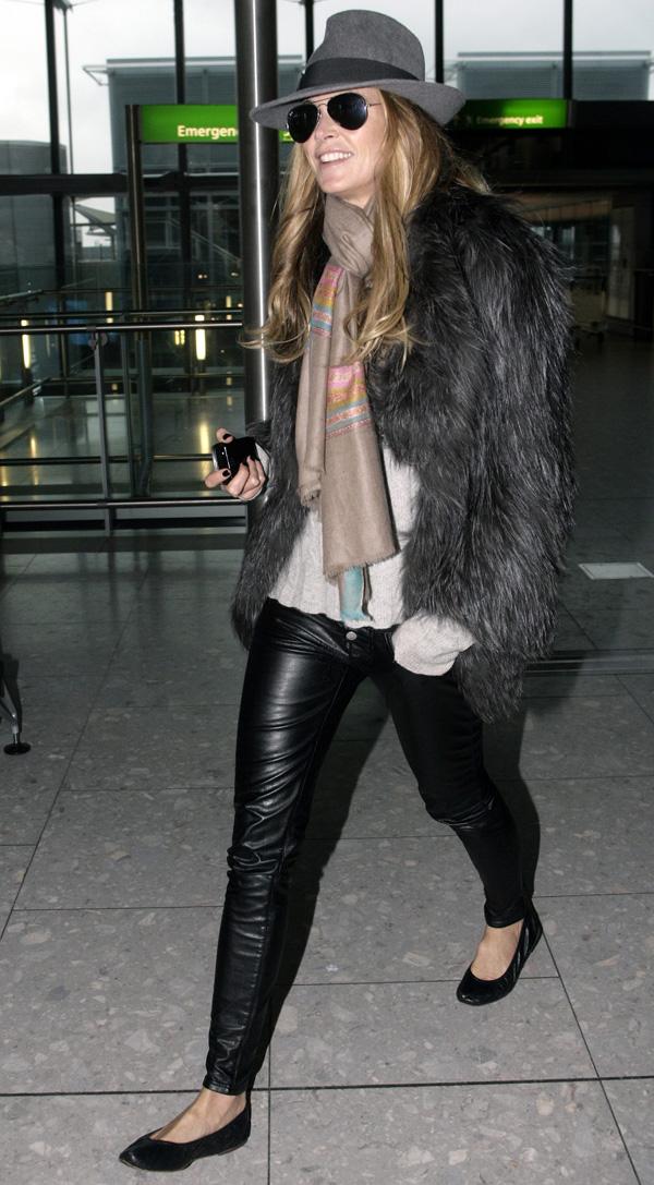 Elle Macpherson at Heathrow Airport in London