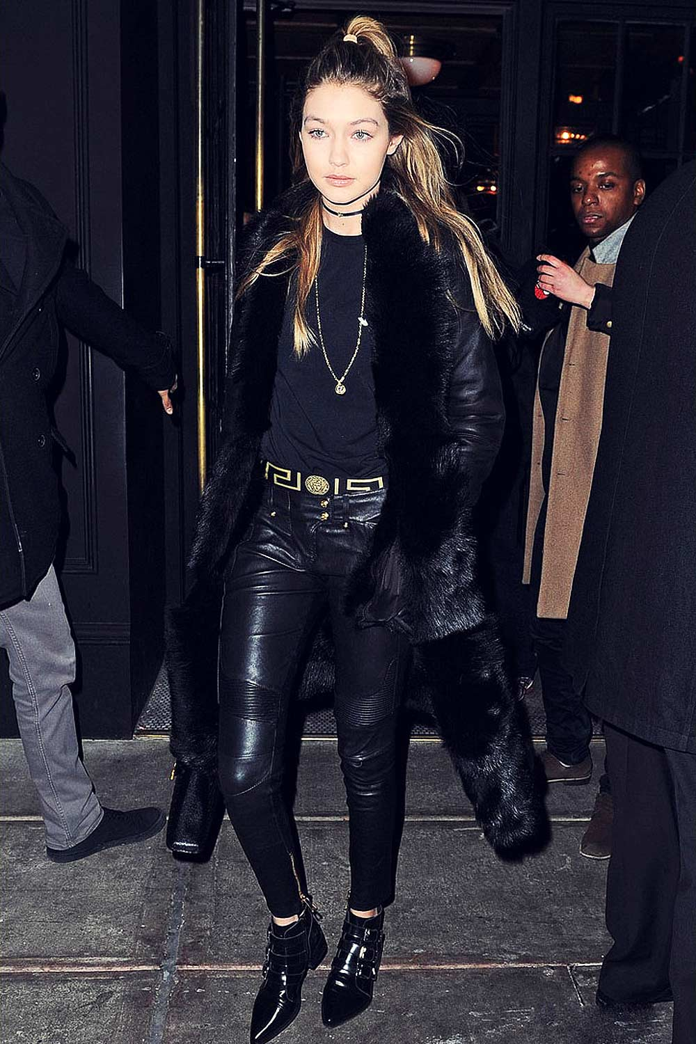 Gigi Hadid step out of an apartment building