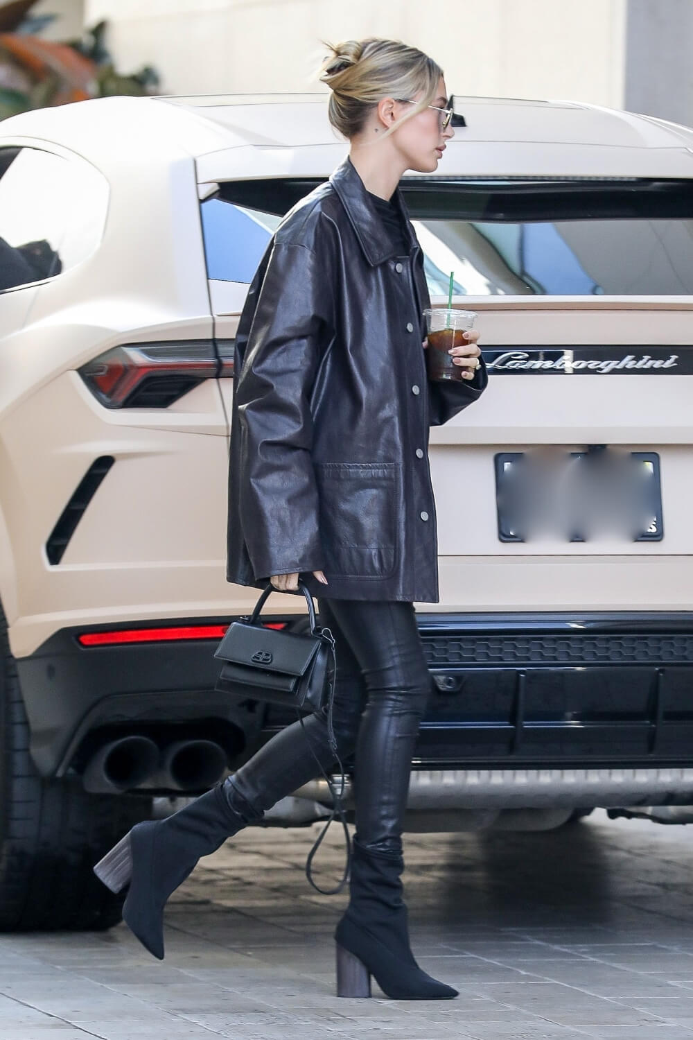Hailey Bieber looks chic in all black ahead of a lunch meeting