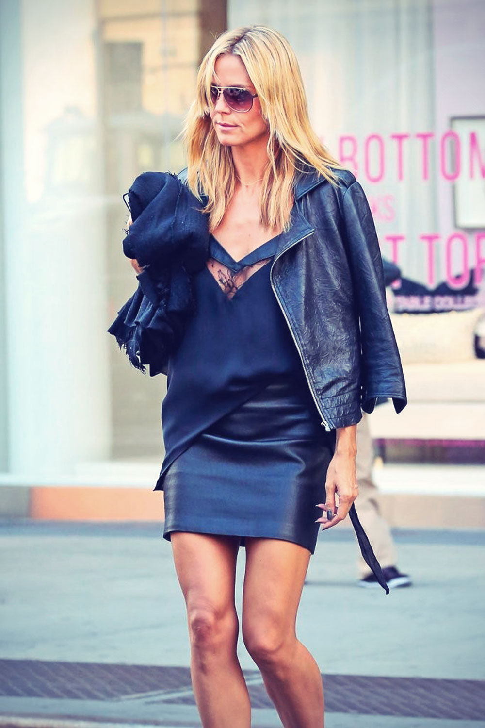 Heidi Klum walking through Soho