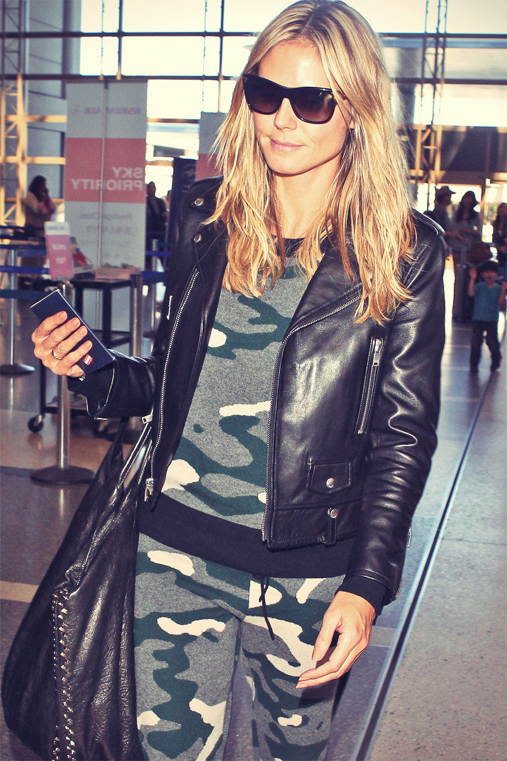 Heidi Klum arriving at Heathrow Airport in Lodon
