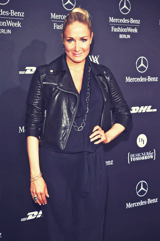 Janine Kunze attends Mercedes-Benz Fashion Week Berlin 2013
