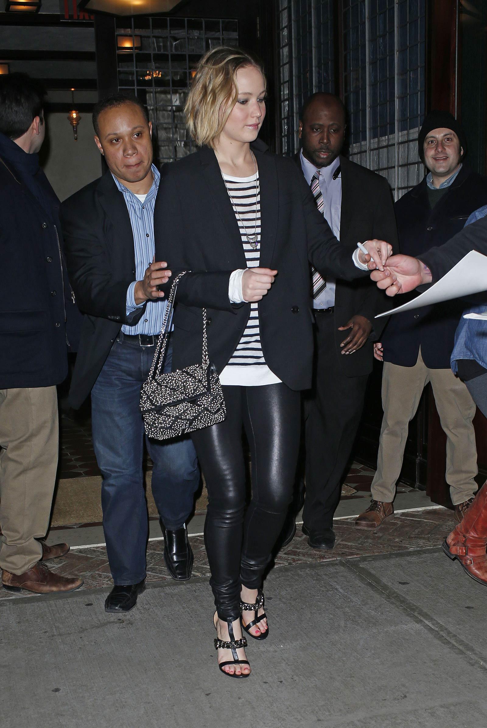 Jennifer Lawrence walking outside of the Greenwich Hotel