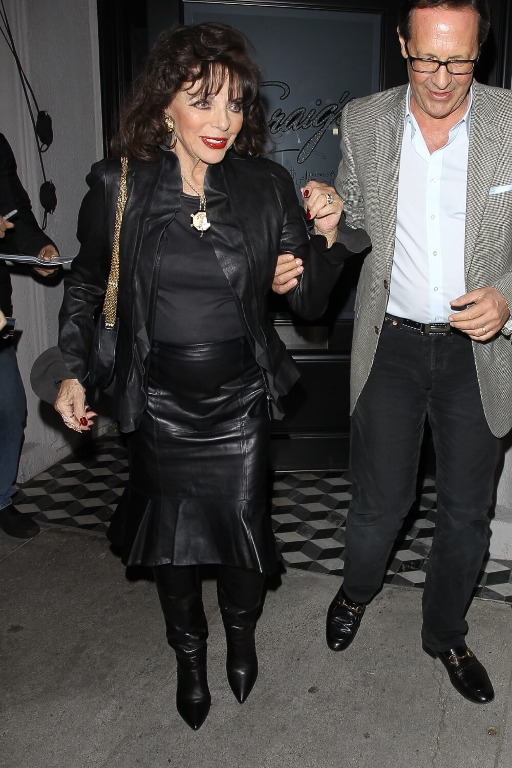 Joan Collins and Percy Gibson enjoy a dinner date