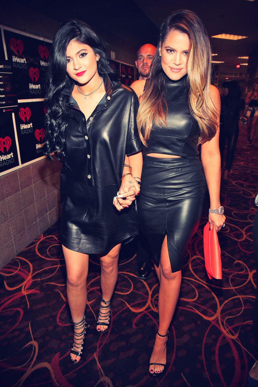 Jenner & Kardashian sisters attend iHeartRadio Music Festival Village