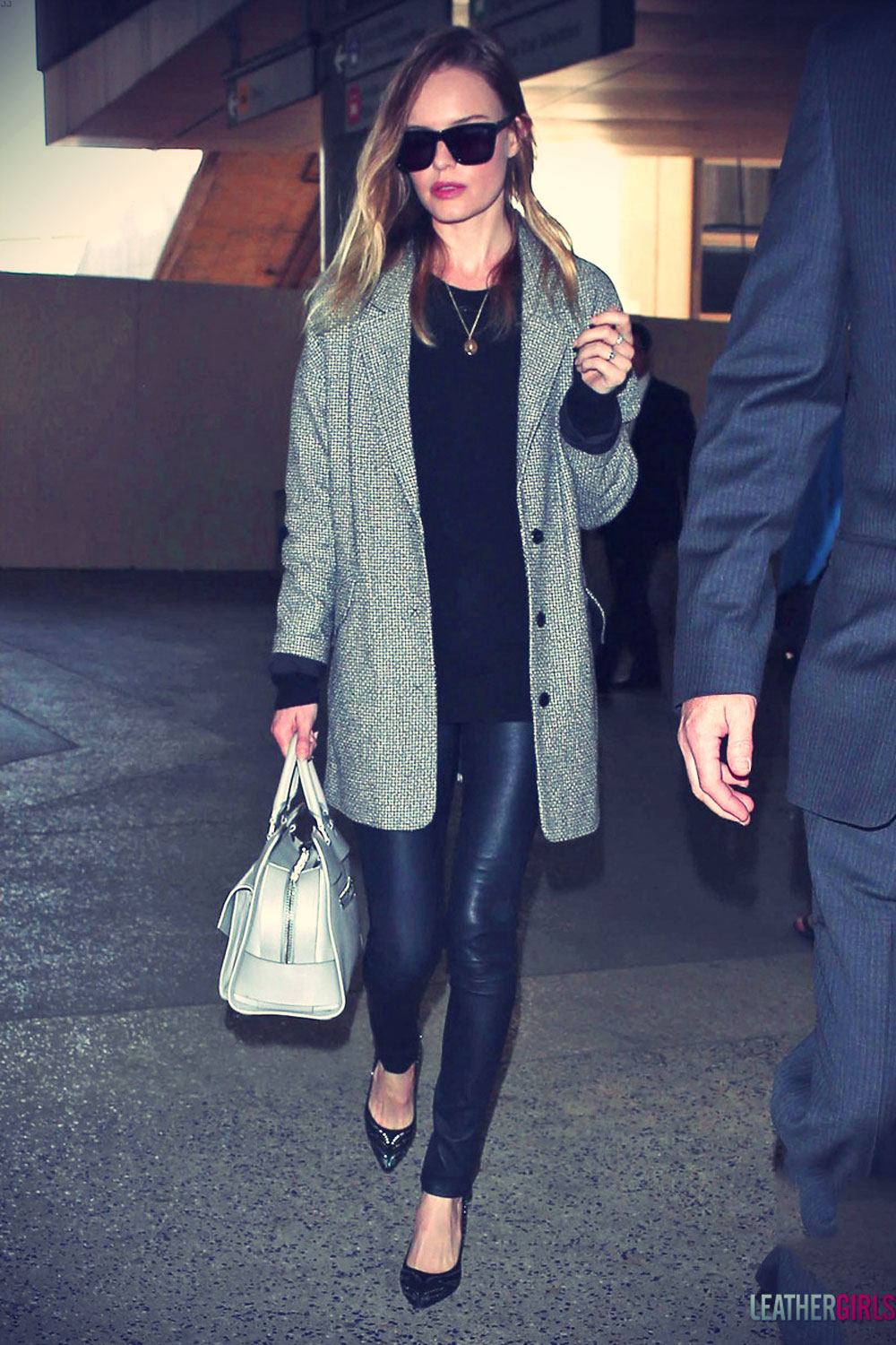 Kate Bosworth bundles up while exiting LAX Airport