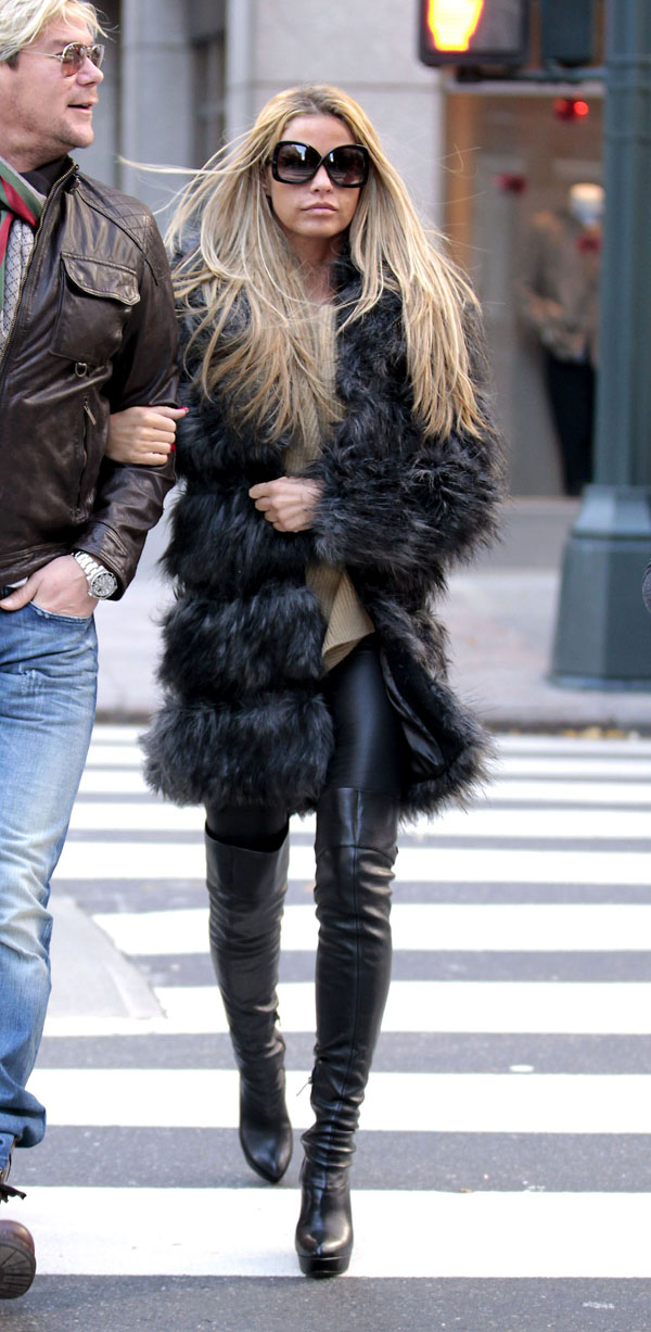 Katie Price walking arm in arm with her friend as they go for breakfast at Grand Central Star Cafe