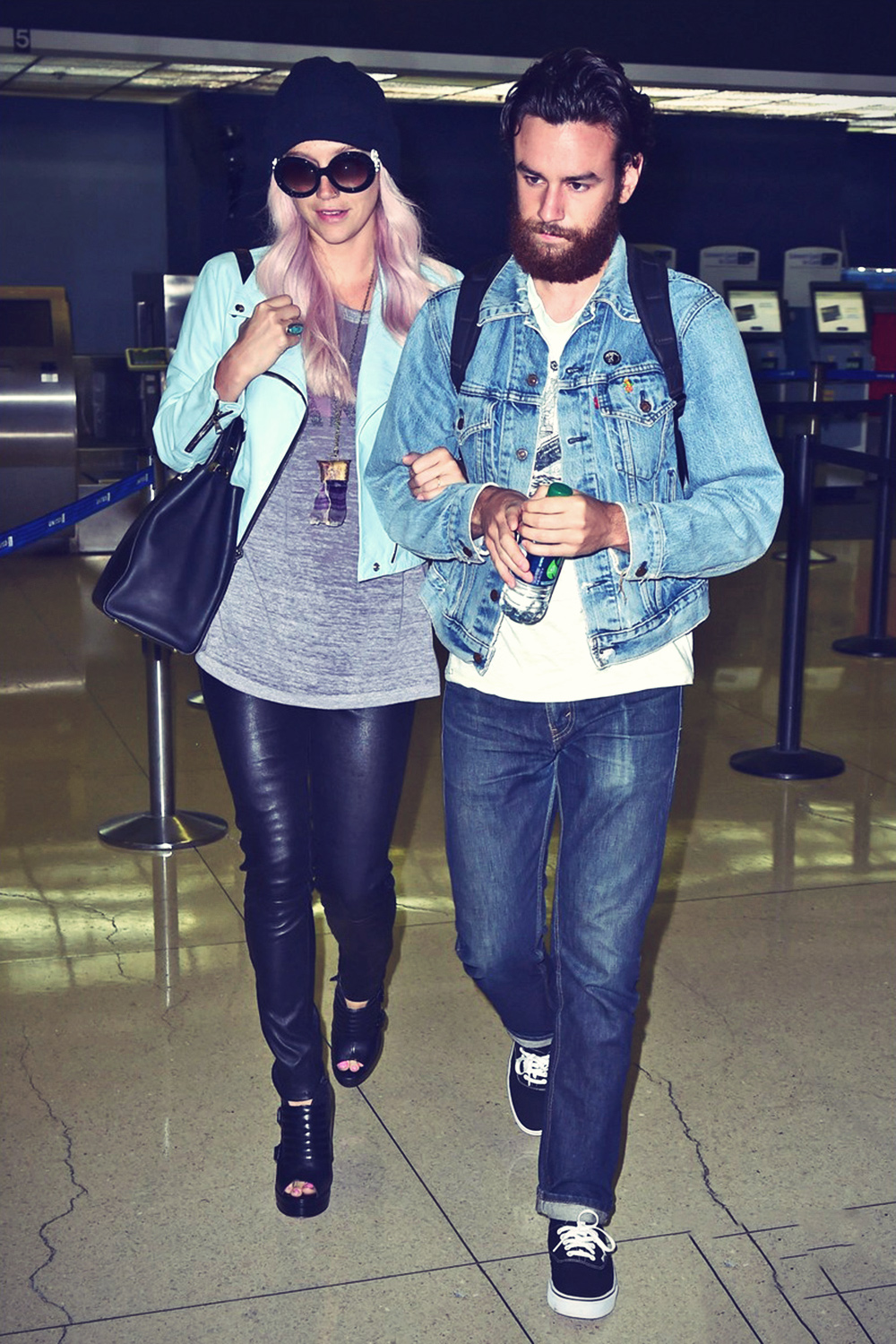 Kesha arrives on an international flight at LAX Airport