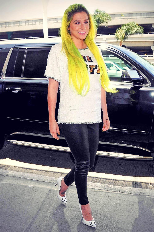 Kesha departing on a flight at LAX airport
