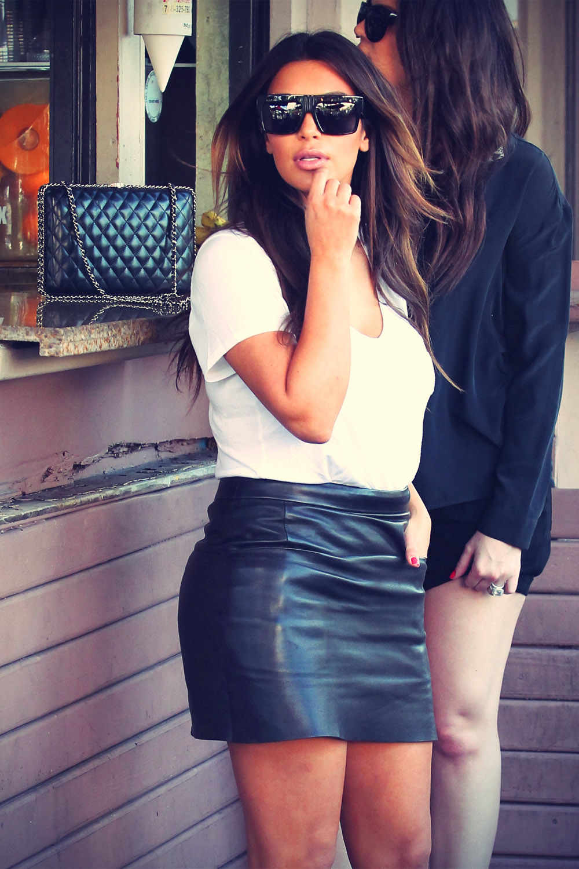 Kim and Khloe Kardashian at a sandwich stand in Miami