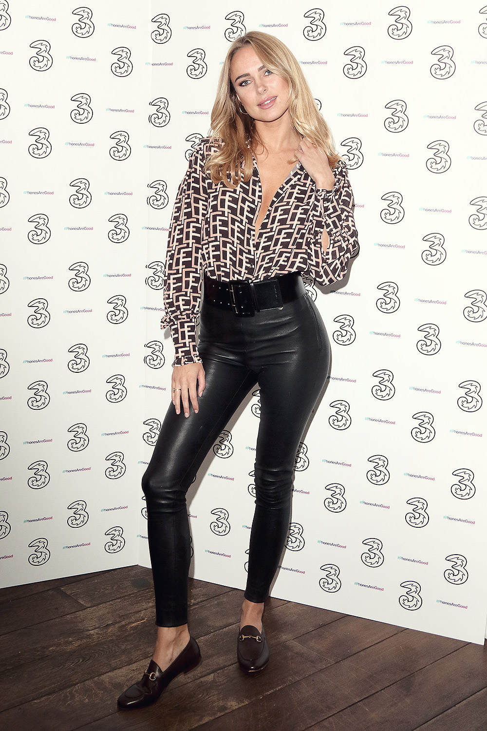 Kimberley Garner attends Portr8's Three Mobiles VIP Gallery Launch